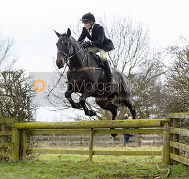 Hilary Butler jumping a hunt jump - The Cottesmore Hunt at Grange Farm