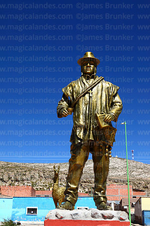 Statue of local man in traditional dress in village square, Curahuara de Carangas, Oruro Department, Bolivia