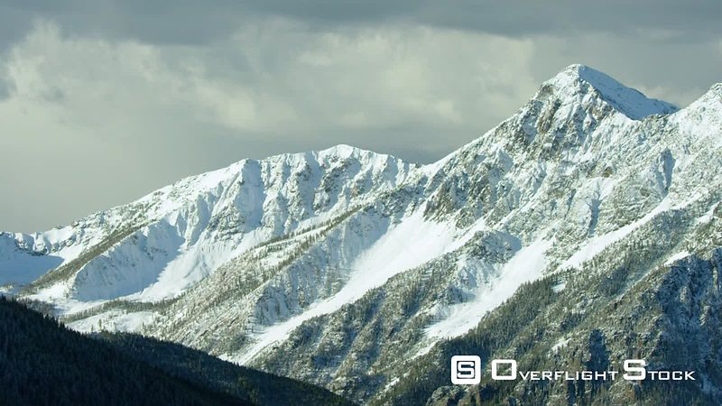 The snowcapped peaks, steep cliffs and dense forestes of the Absaroka mountain Range near Yellowstone National Park