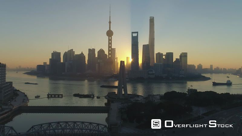 Panoramic Shanghai Skyline at Sunrise. China. Aerial View. Drone is Flying Forward over Monument to the People's Heroes. Establishing Shot.