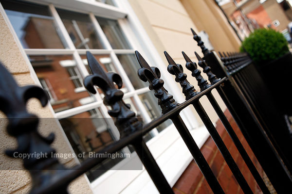 Black wrought iron railings outside of a town house in Worcester, UK