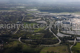 Manchester high level aerial view of M56 motorway junction 5 looking towards Business Parks and car parking and Manchester Airport Terminals