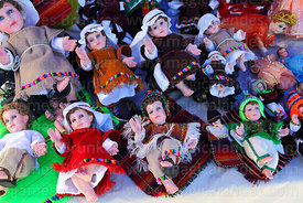 Baby Jesus figures for nativity scenes wearing traditional Andean clothing for sale in Christmas market, Bolivia