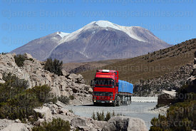 Truck on Highway 11, Guallatiri volcano in background, Lauca National Park, Region XV, Chile