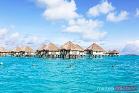 Overwater bungalows in the lagoon of Bora Bora, French Polynesia
