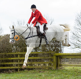 Nicholas Leeming jumping a hunt jump - The Cottesmore Hunt at Grange Farm