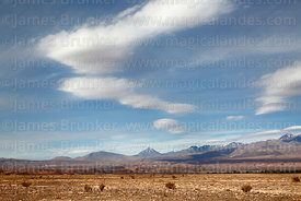 View north across desert near San Pedro de Atacama to Cerro Colorado volcano (centre), Region II, Chile