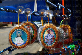 Icons of Virgen de Chaguaya and San Roque for sale on stall outside Sanctuary, Chaguaya, Tarija Department, Bolivia