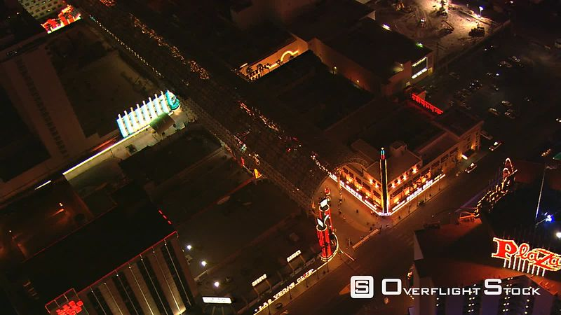 Orbiting Main Street casinos in downtown Section of Las Vegas at night.