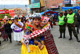 The official pepino hugs the official cholita at start of parades for the Entierro del Pepino, La Paz, Bolivia