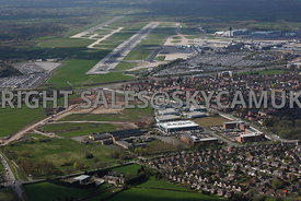 Manchester aerial photograph of Manchester Airport showing Terminal buildings and runways and Ringway Trading Estate and the old Ferrantic Electronics factory Simonsway Wythenshaw