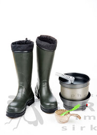 Rubber boots with Hiking equipment: stove and cup