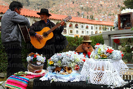 Men playing guitars in cemetery as tribute to skulls, Ñatitas festival, La Paz, Bolivia