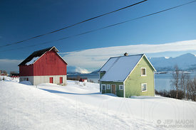 Colorful timber houses by fjord