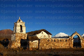 Rustic church near Lagunas, Parinacota volcano behind, Sajama National Park, Bolivia