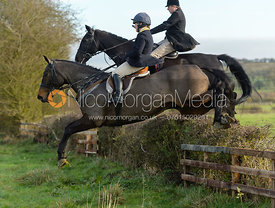 Bella Higham jumping a hedge on Deane Bank
