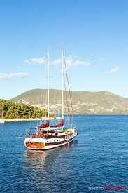 Sail boat in the harbour of Fiskardo. Kefalonia, Greek Islands, Greece