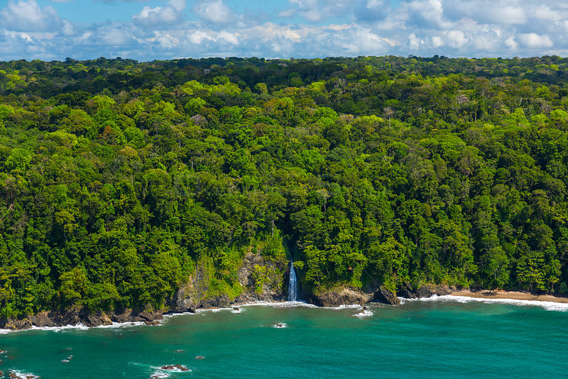 Aerial view of waterfall on the coastline of Corcovado National Park, Osa Peninsula, Puntarenas Province, Costa Rica. December 2014.