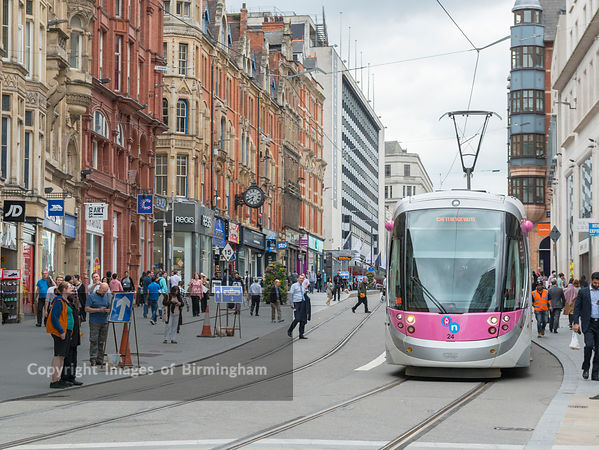 Electric trams on Corporation Street in Birmingham City Centre