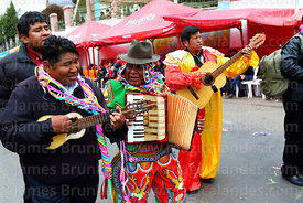 Musicians playing charango, accordion and guitar during parades for the Entierro del Pepino, La Paz, Bolivia