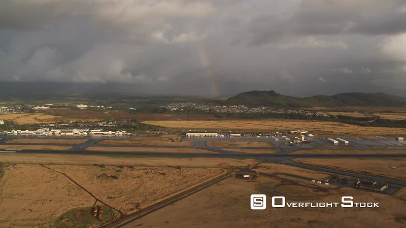 Approaching Lihue Airport at sunrise with rainbow, Hawaii.