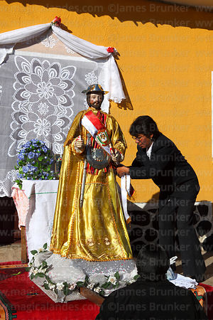 Woman preparing statue of San Bartolome at start of Chutillos festival, Potosí, Bolivia