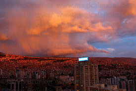 Dramatic storm clouds over La Paz at sunset during rainy season , Bolivia