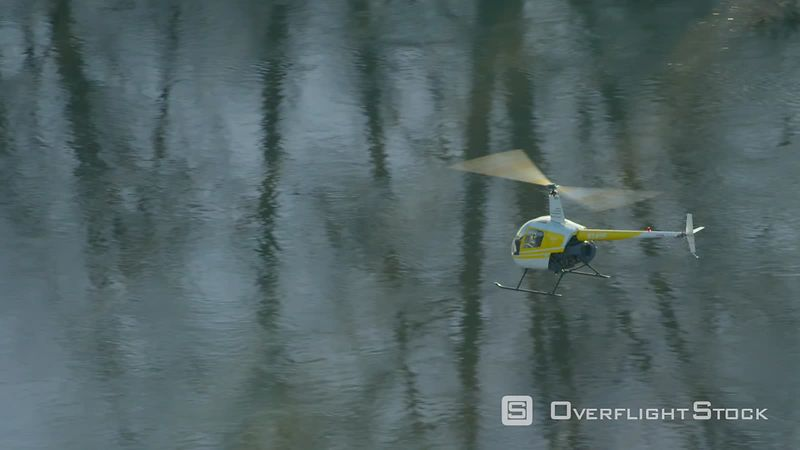 Helicopter flying over river in Oregon