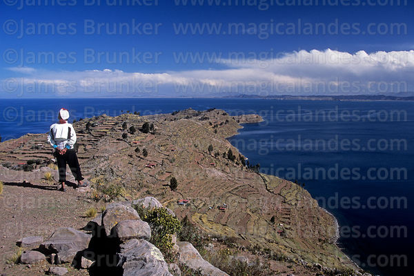 Local man looking at view over Lake Titicaca, Taquile Island, Peru