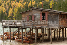 Wooden boathouse at famous Lago di Braies in the Dolomites, South Tyrol, Italy.