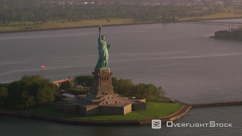 New York City Aerial view of Statue of Liberty at sunrise, Manhattan.  Shot with Cineflex and RED EpicW Helium.
