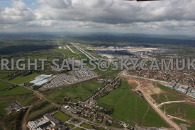 Manchester high level aerial photographs of Manchester Airport runways new developments and Terminal buildings