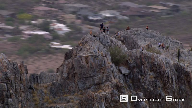 Close flight past Squaw Peak (Piestewa Peak) near Phoenix, people on ridge top.