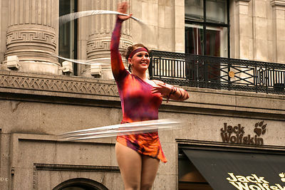 Female Circus Performer Spinning Rings on Stage