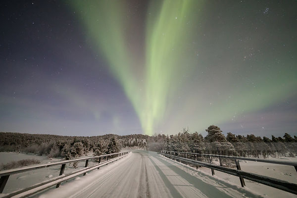 Aurora above a bridge in Finnish Lapland