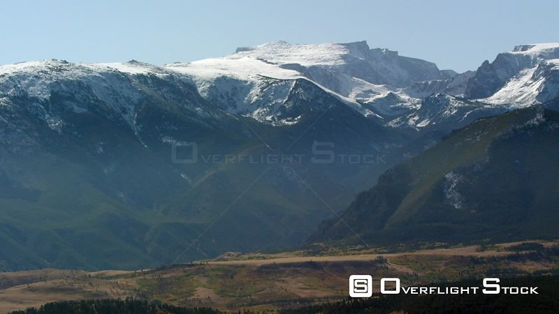 The northern flank of the Beartooth mountain Range near Red Lodge, Montana showcases a coat of early autumn snow