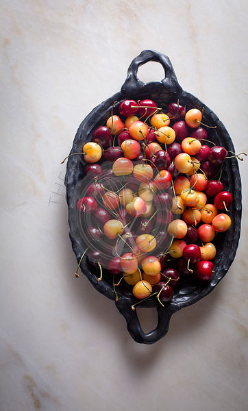 Cherries in a ceramic plate on top view