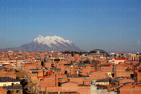 View over brick buildings to Mt Illimani, El Alto, Bolivia