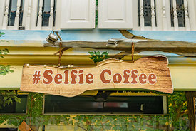 "SINGAPORE CITY, SINGAPORE - OCTOBER 08, 2016:  A""Selfie Coffee"" sign above a cafe in Haji Lane, Singapore.  The street is a popular place for tourists with lots of stores with various souvenir shops, fashion boutiques, and cafes."