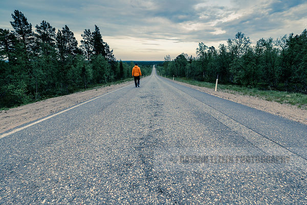 Walking down the road in Finnish Lapland