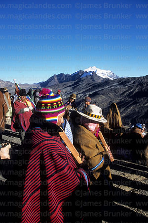 Aymara tarqueada musicians playing tarkas (a type of flute) during Aymara New Year celebrations, La Cumbre, Cordillera Real, Bolivia
