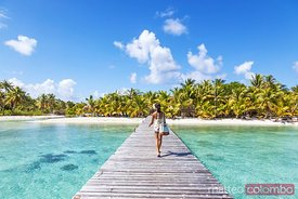 Tourist walking on jetty, Tikehau atoll, French Polynesia