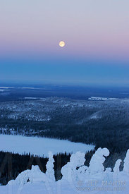 Full moon over winter landscape