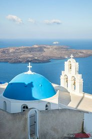 Typical blue domed church overlooking mediterranean sea, Santorini, Greece