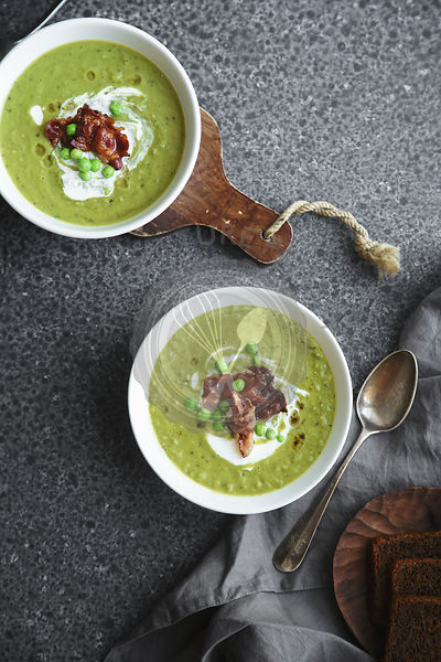 Pea soup with fried bacon