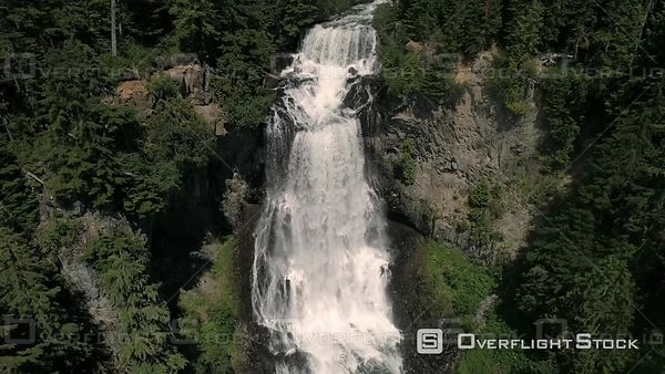 Drone shot floating close to cascading waterfalls by Whistler