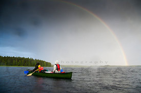Rainbow And Paddlers, Raindrops in Camera Lens