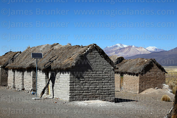 Solar panel next to thatched adobe house in Estancia Huincurata, Sajama National Park, Bolivia