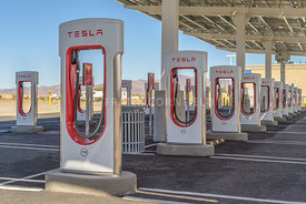 BAKER, USA - FEBRUARY 16, 2018: Tesla Supercharger charging station for recharging electric vehicles at Baker in southern California.  This site has 40 Superchargers.