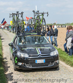 The Car of Cannondale Team on the Roads of Paris Roubaix Cycling Race